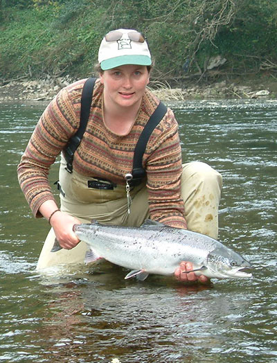 Glenda Powell releases a salmon